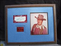 JOHN WAYNE (Actor) 1907-1979. Cut signature framed with a photo of Wayne .   The framed signature makes a very attractive piece and is ready to display…795.00