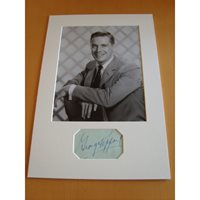 A signed page by George Peppard mounted with a 10x8 photograph. George Peppard.