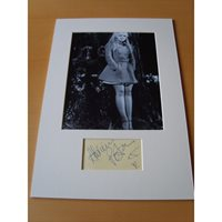 A signed page mounted with a 10x8 photograph. Adrienne Posta.