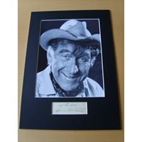 A signed page mounted with a 10x8 photograph. James Whitmore 1.