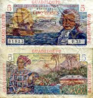 """Guadeloupe 5 Francs Pick #: 31 1947-49 VG (see large scan)Other Caribbean Island (French Owned - so now use Euro) Blue Bougainville; Woman with basket of fruit; House with mountain in backgroup; GuadaloupeNote 4 1/4"""" x 2 1/4"""" North and Central America None Discernible"""