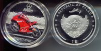 "Palau 1 Dollar 2009 Gem (presentation case & Box show wear)Other 2009 Palau Proof Color coin. Ducati Casey Stoner Motorcycle (silver plated - boxed) Motorcycle racer; Shield - Rainbow's End; boat (NB: Outer box and presentation cases show wear)Coin 1 1/2"" (circular)"