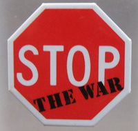 STOP THE WAR figural stop sign shaped pinback button