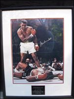 MUHAMMAD ALI (Heavyweight Boxing Champion) Superb 16X20 signed color photo. The photo was obtained during a private signing and then nicely framed to strict museum standards.  This is an outstanding display piece…749.00